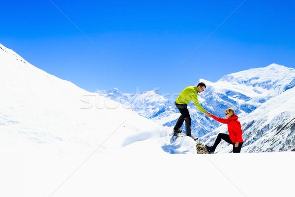 Segítő kéz pár túrázók hegyek kirándulás segítség Stock fotó © blasbike