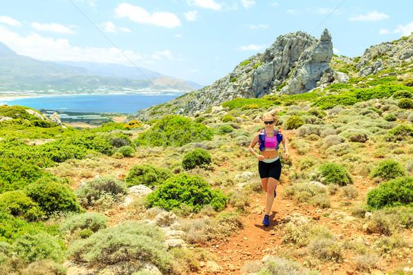 Happy woman trail running in beautiful mountains Stock photo © blasbike