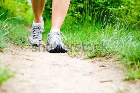 Woman walking in city park Stock photo © blasbike
