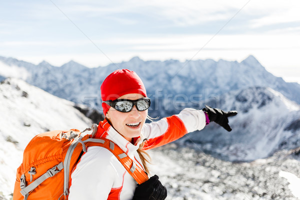 Hiking success, happy woman in winter mountains Stock photo © blasbike