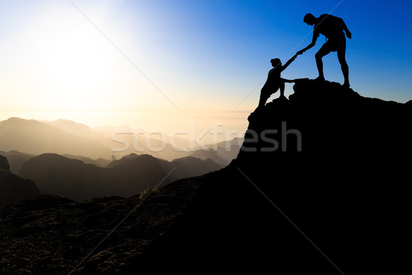 Teamwork couple hiking helping hand Stock photo © blasbike