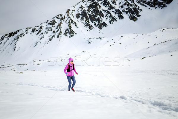 Winter running woman. Trail runner inspiration, sport and fitnes Stock photo © blasbike