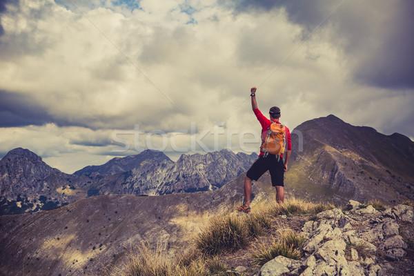 Stock photo: Hiking success, man runner in mountains