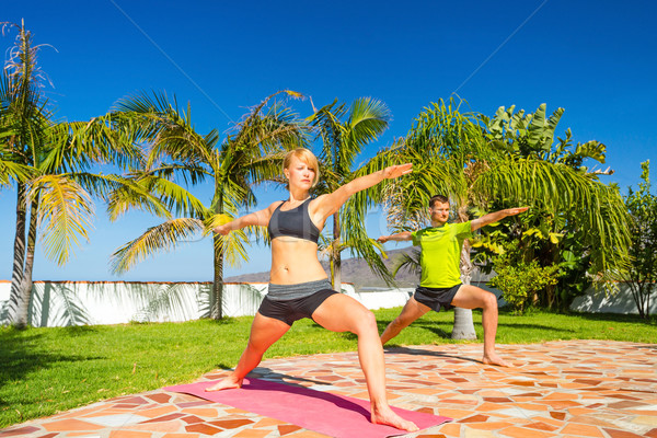 Woman and man doing yoga outdoors Stock photo © blasbike