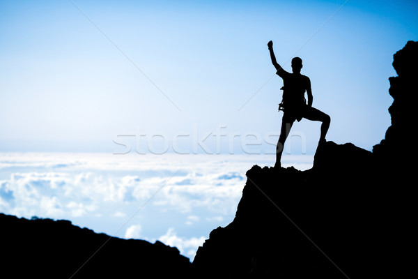 Hiking success, man hiker runner climber in mountains Stock photo © blasbike