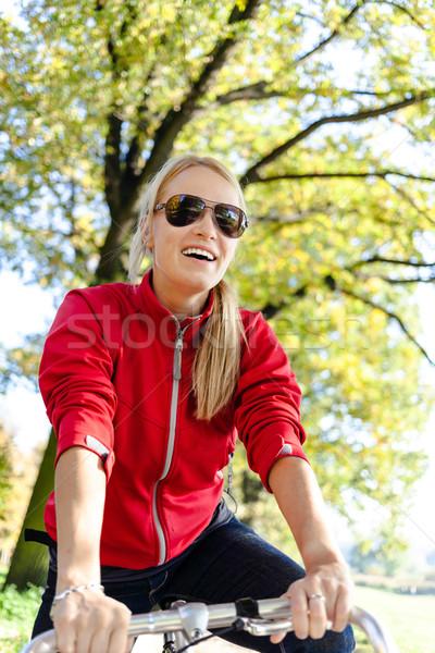 Happy woman cycling on bicycle Stock photo © blasbike
