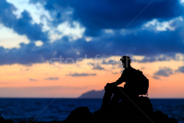 Hiking silhouette backpacker, man trail runner in mountains Stock photo © blasbike