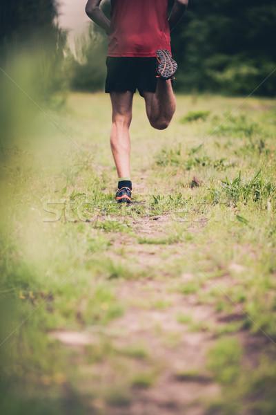 Man runner cross country running on trail Stock photo © blasbike