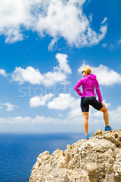 Happy trail runner looking at inspirational landscape Stock photo © blasbike