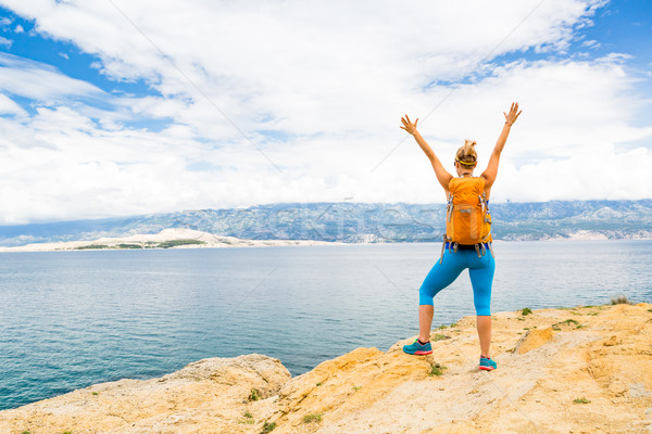 Woman hiker with arms outstretched, travel celebrating Stock photo © blasbike