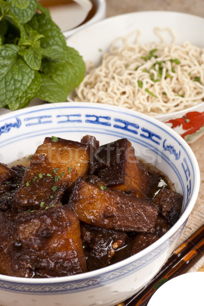 Braised Pork Belly Slices Cooked in Dark Soy Sauce Stock photo © blinztree