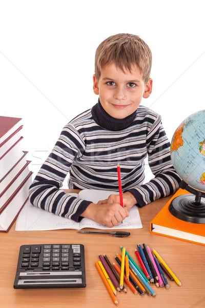 Stock photo: Cute schoolboy is writting