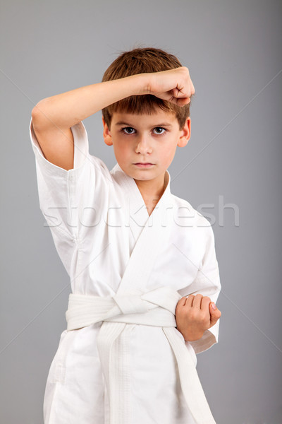 Karate boy in white kimono fighting Stock photo © bloodua
