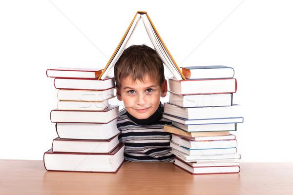 écolier tas livres isolé blanche sourire Photo stock © bloodua