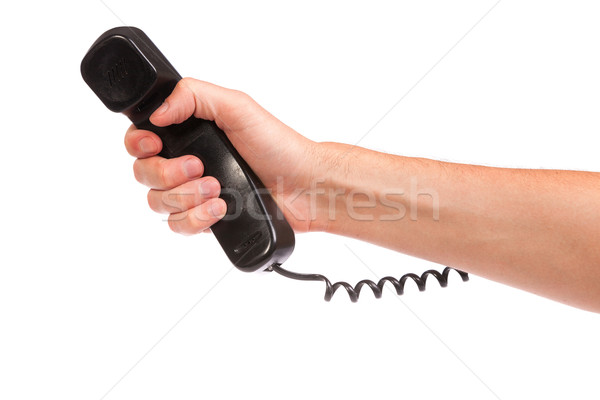 Hand holding an old black telephone tube Stock photo © bloodua