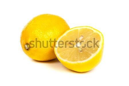 Fresh lemons on white background Stock photo © bloodua