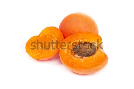 Apricots. Group of ripe apricots with a half sectioned by knife Stock photo © bloodua