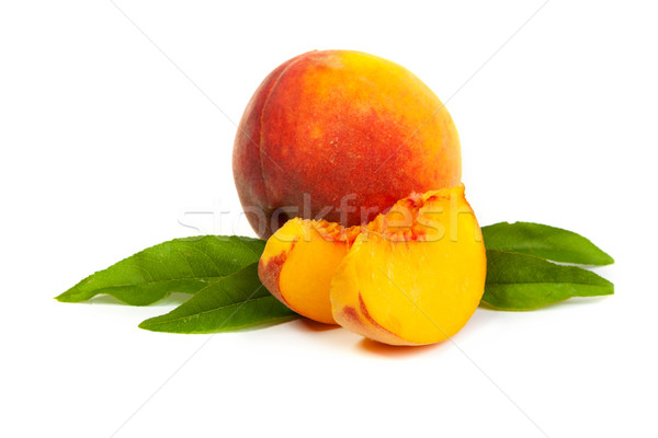 One perfect, ripe peache with slices isolated on a white backgro Stock photo © bloodua