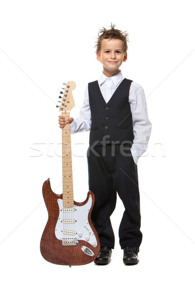 Boy holding a guitar Stock photo © bloodua