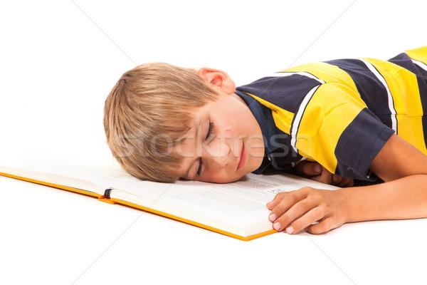 Fáradt iskolás fiú izolált fehér kéz könyv Stock fotó © bloodua