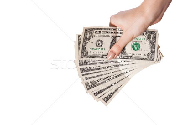 Female hand holding money dollars isolated on white background Stock photo © bloodua