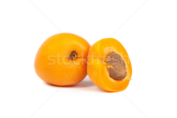 Two ripe apricot sectioned by knife Stock photo © bloodua