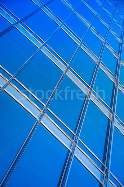modern blue glass wall of skyscraper Stock photo © bloodua