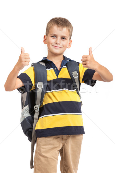 Schoolboy sitting on books Stock photo © bloodua