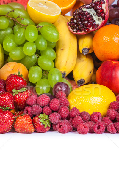Huge group of fresh fruits isolated on a white background. Stock photo © bloodua