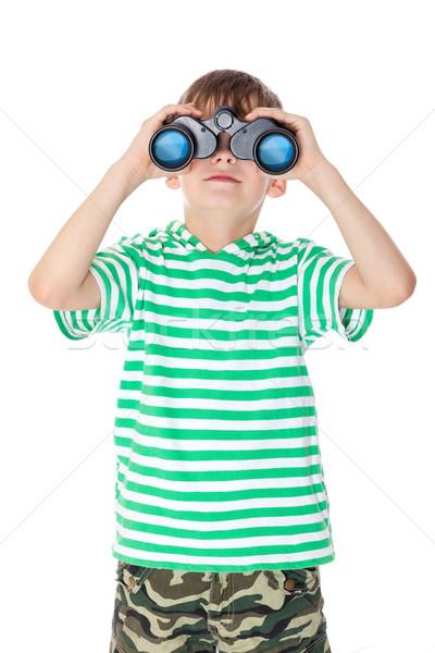 Boy holding binoculars Stock photo © bloodua