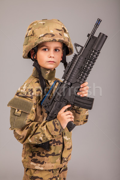 Young boy dressed like a soldier with rifle Stock photo © bloodua