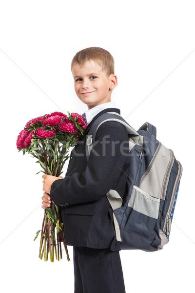 Schoolboy is holding flowers. Back to school Stock photo © bloodua