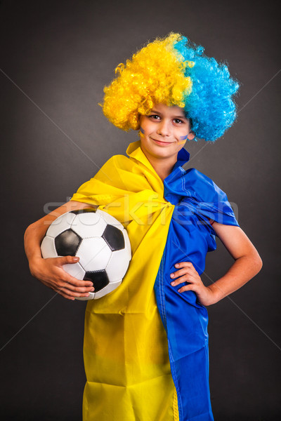 Football fan with  ukrainian flag on a black background Stock photo © bloodua