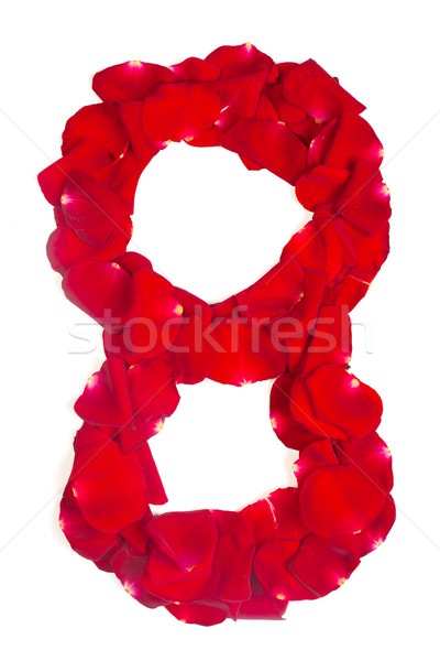 number 8 made from red petals rose on white Stock photo © bloodua