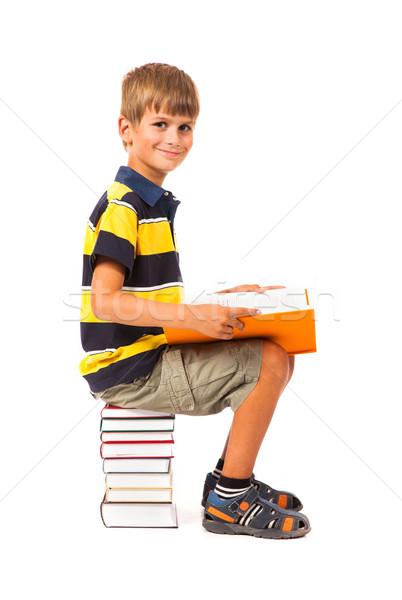 Scolaro seduta libri isolato bianco carta Foto d'archivio © bloodua