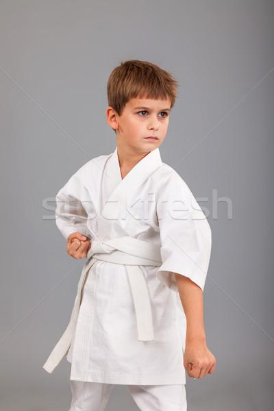Karatê menino branco quimono isolado Foto stock © bloodua