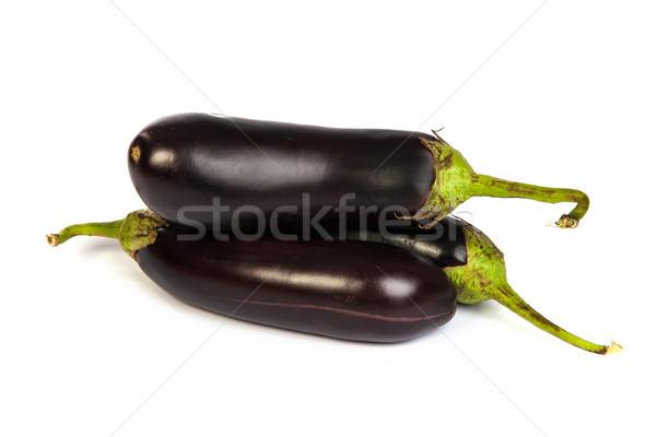 Three large eggplant, over white background Stock photo © bloodua