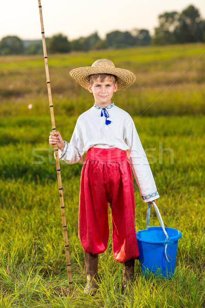 Photo of little kid pulling rod while fishing on weekend Stock photo © bloodua