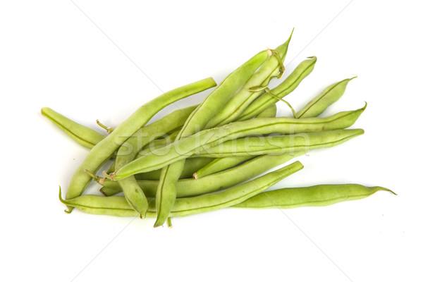 Bunch of fresh green beans on white Stock photo © bloodua