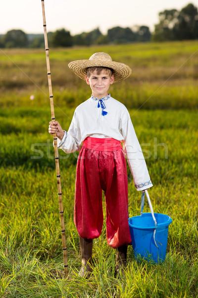 Young cute boy fishing in a river Stock photo © bloodua
