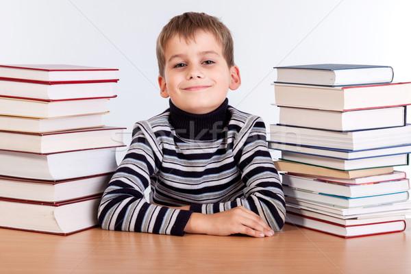 Schooljongen hoop boeken geïsoleerd witte glimlach Stockfoto © bloodua