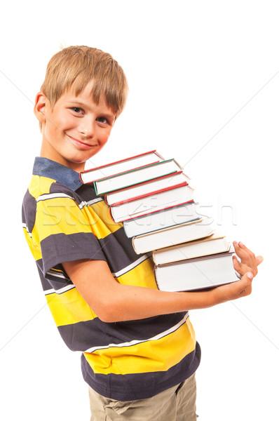 Iskolás fiú tart könyvek izolált fehér papír Stock fotó © bloodua