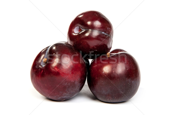 Group of plums  on white Stock photo © bloodua