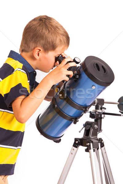 Criança olhando telescópio branco estrela pequeno Foto stock © bloodua