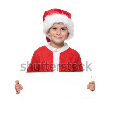 Boy holding a christmas poster Stock photo © bloodua