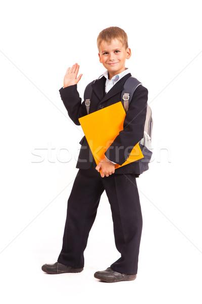 Iskolás fiú narancs könyv izolált fehér kéz Stock fotó © bloodua