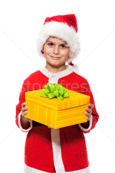 Boy holding a christmas gift Stock photo © bloodua