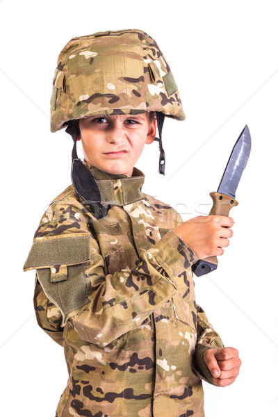 Young soldier with knife Stock photo © bloodua
