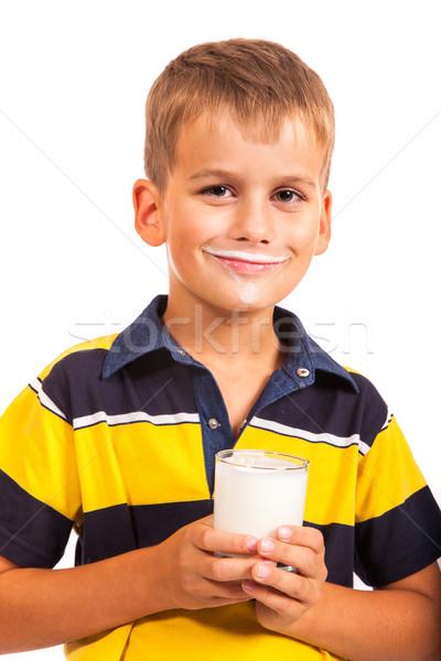 Young boy has moustache of milk on his lips Stock photo © bloodua