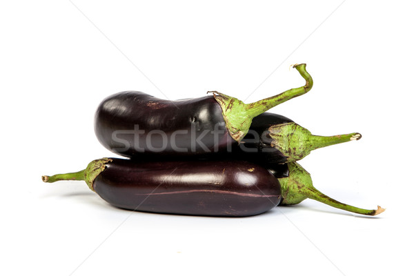 Three large eggplant, over white background Stock photo © bloodua
